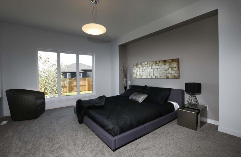 <p>The spacious master bedroom includes an ensuite bathroom and walk-in closet with a window. </p>