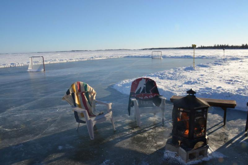 <p>After five years, Blair Sonnichsen put his idea into practice — building an 80 by 140 foot rink on Lake Winnipeg. He even has a fire pit nearby.</p></p>