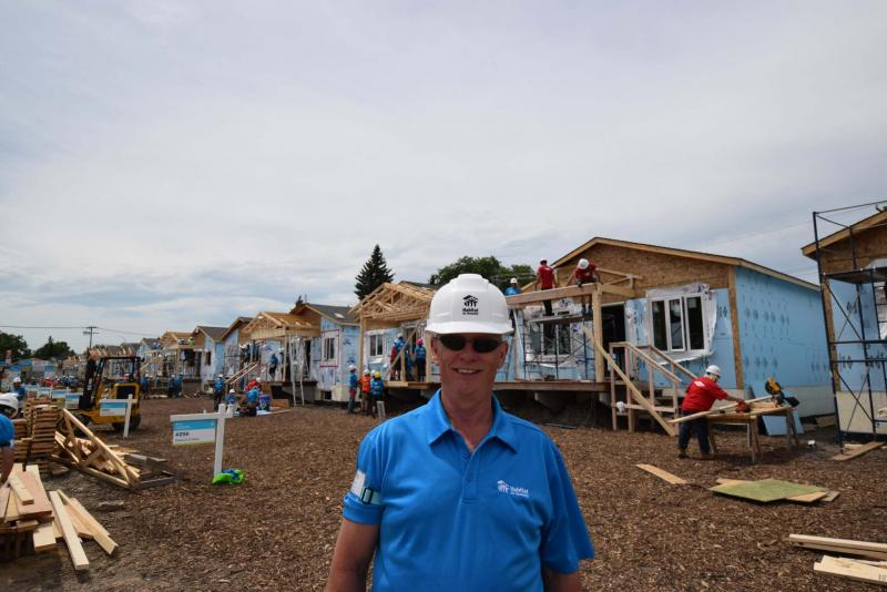 <p>Photos by Todd Lewys</p><p>Habitat for Humanity Manitoba CEO Sandy Hopkins stands in front of construction at the project at 210 Lyle Street in St. James.</p>