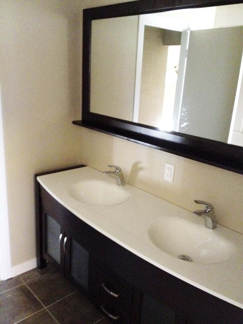 <p>Upper floor bathroom with dual sink vanity and full width mirror with shelf.</p>