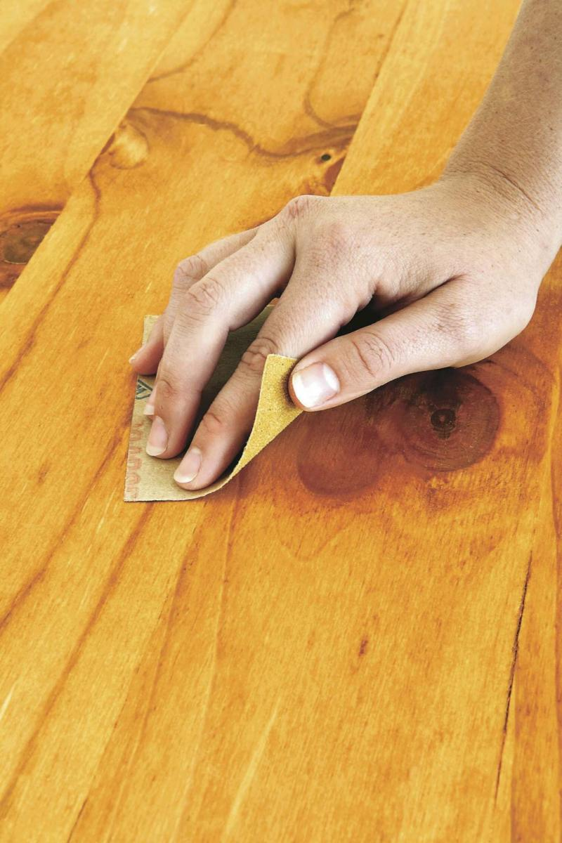 <p>File photo / The Associated Press</p><p>Fill cracks and holes in a wood table with wood-filler epoxy, let harden, then lightly sand the surface with 180-grit sandpaper. </p></p>