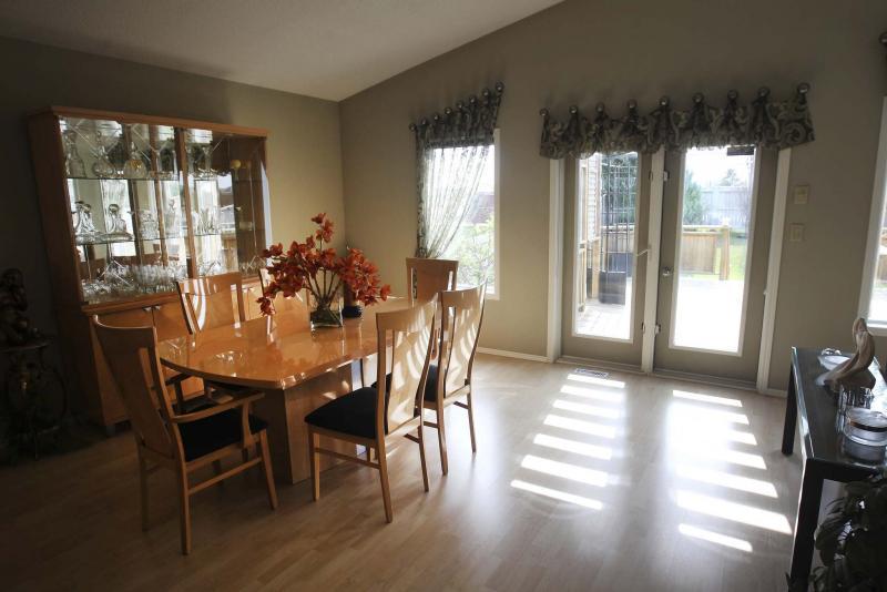 <p>JOE BRYKSA / WINNIPEG FREE PRESS</p><p>A large window and sliding patio doors help bathe the dining room in natural sunlight.</p>