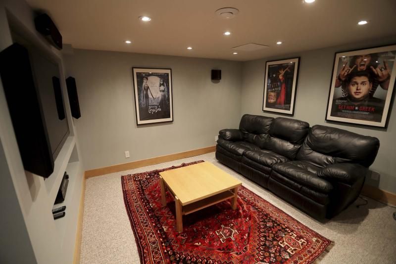 <p>TREVOR HAGAN / WINNIPEG FREE PRESS</p><p>The home's media are features a built-in entertainment unit, pot lights and pair of built-in speakers.</p>
