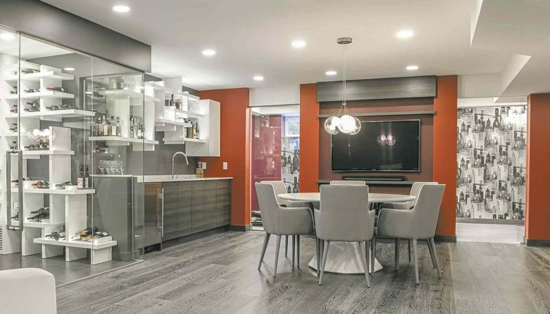 This Lower Level Features An Entertaining Space Games Area Wine Room Bar Gym Home Office Guest Sleeping Murphy Bed In Wall Units
