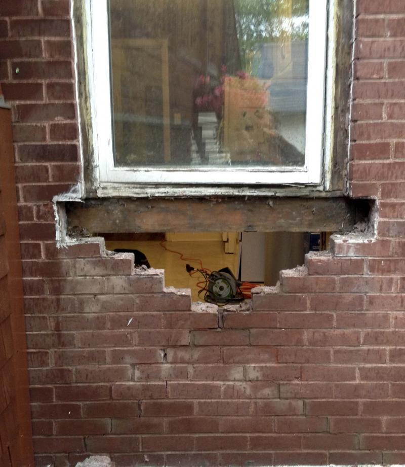 <p>The initial stages of brick removal during the wall breach to create the new back door.</p>