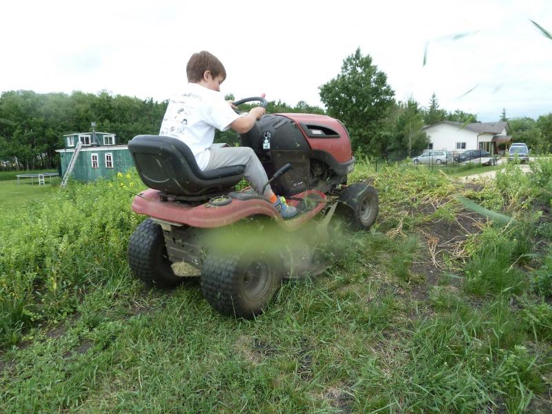 <p>Ryan enjoys using the mower so much that it's hard to keep him off it.</p>