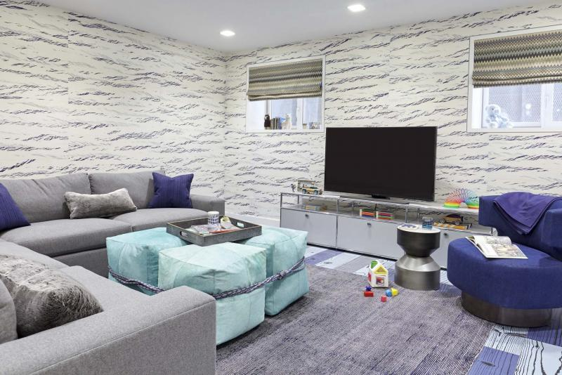 <p>RYAN DAUSCH / JENNY KIRSCHNER / THE ASSOCIATED PRESS</p><p>Cheerful colour and cosy furnishings with warm, soft upholstery transform a basement into an inviting and family friendly space.</p>