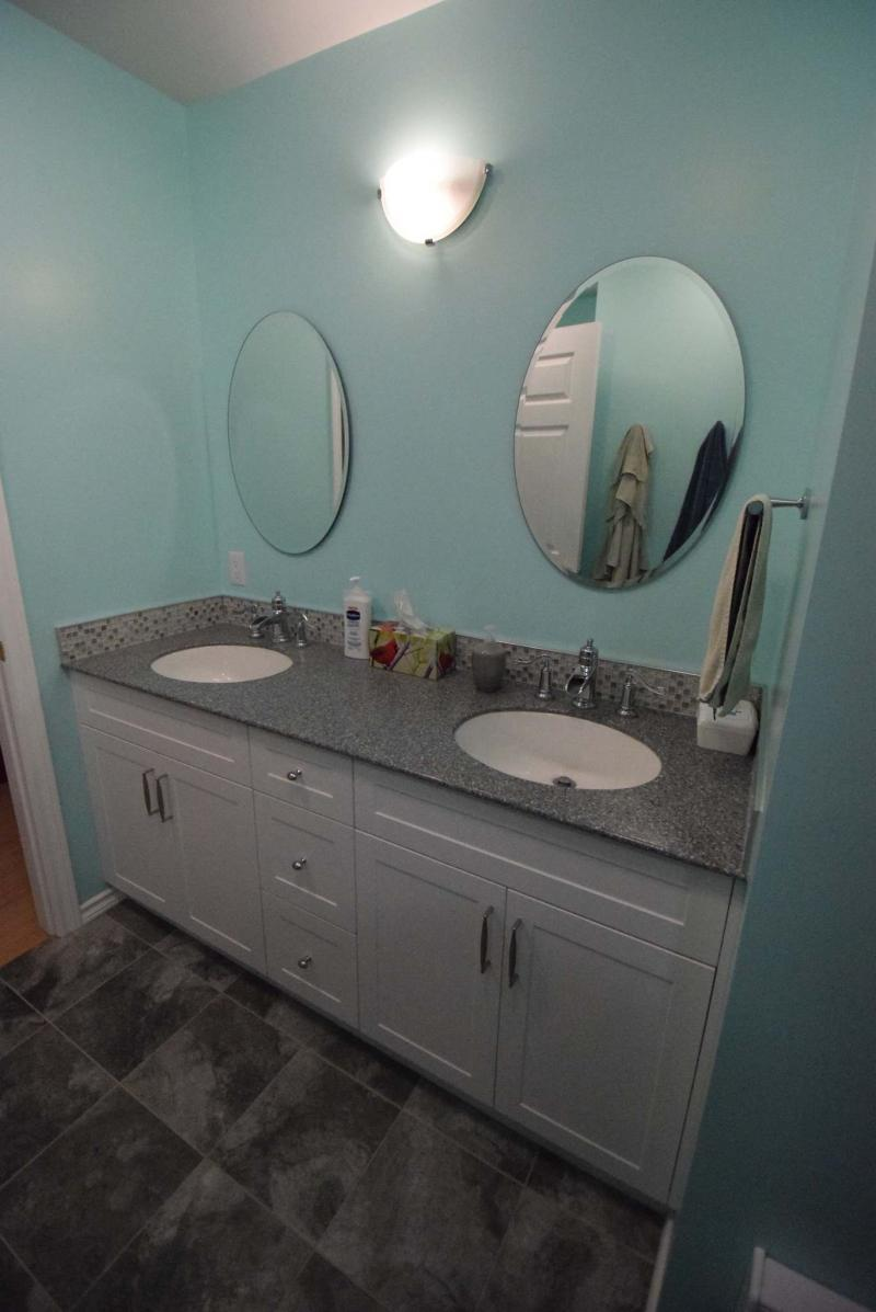 <p>Todd Lewys / Winnipeg Free Press</p><p>Style and utility meet with a large white vanity featuring loads of storage, dual sinks, tile trim and a grey countertop.</p>