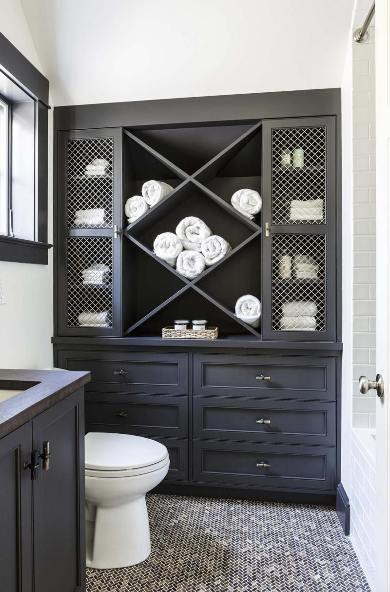 <p>Angie Seckinger</p><p>Take advantage of the wall space in a compact bathroom. A tall cabinet or a medicine cabinet over the toilet can make a big difference.</p>