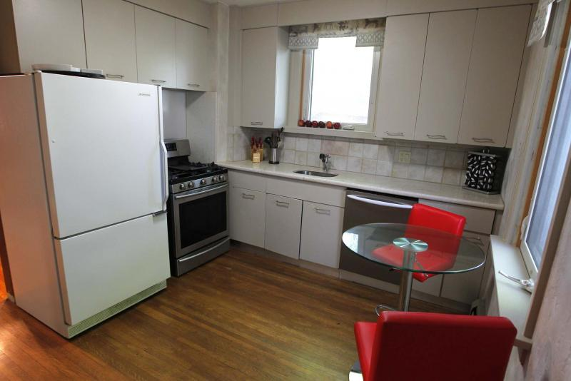 <p>The kitchen features modern cabinets and newer granite countertops. </p>