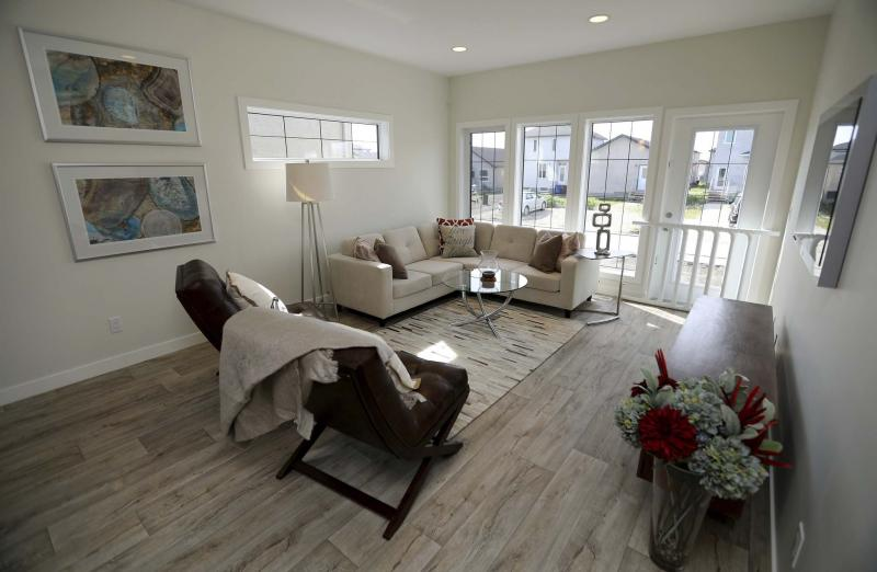 Comfort zone winnipeg free press homes for Laminate flooring winnipeg