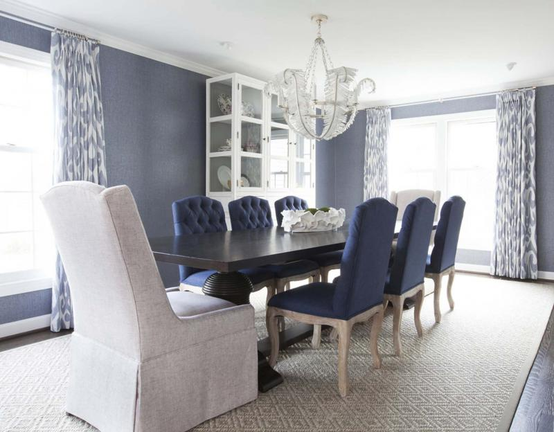 <p>Marigold Photography</p><p>A dining room designed by Erica Burns uses contrasting host chairs at the ends of the table to avoid a matchy-matchy look. </p>