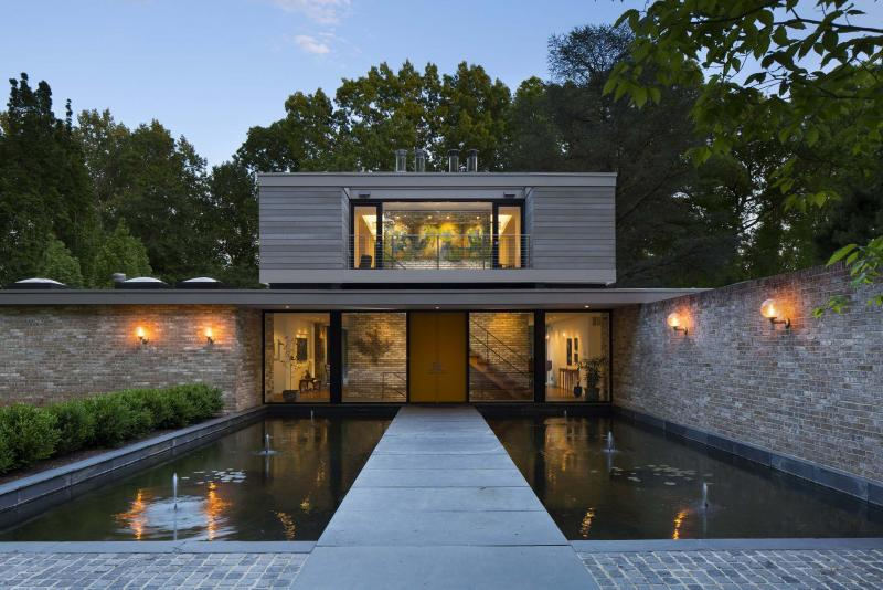 <p>Ted and Ruth Kassinger's Bethesda, Md., home was originally designed by noted architect Hugh Newell Jacobsen. They overhauled it and added a library (above). The kitchen and the living room, which looks out onto the grounds, were also part of the extensive renovations.</p>
