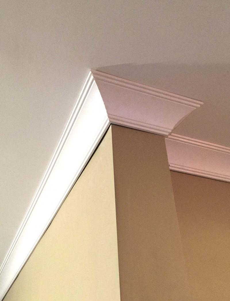 <p>45-degree spring angle crown mouldings installed at Roland Lavoie's house, after having strapped new drywall to the ceiling to cover up old plaster ceilings covered in stipple paint.</p>