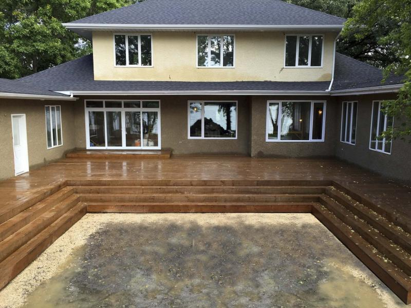 <p>Main area of water-side deck with wrap-around stairs. </p><p>Photos by Marc LaBossiere / Winnipeg Free Press</p></p>