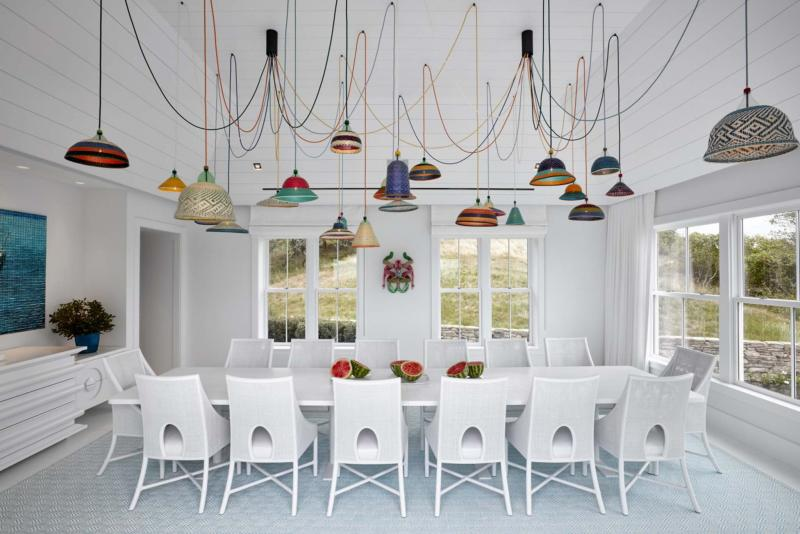 <p>Garrett Rowland / Associated Press</p><p>One of the rooms in a Montauk, N.Y., beach house featuring Ghislaine Viñas' design. The bold, colourful statement lighting becomes not only illumination but art.</p>