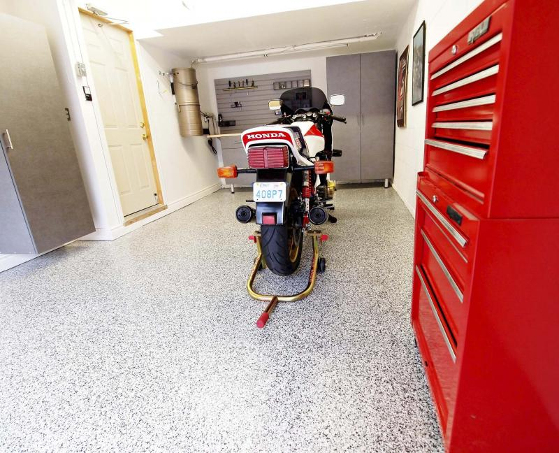 <p>Chris Balcerak / Postmedia files</p><p>Frequently opening and closing the door to your attached garage can warm it up, which causes ice and snow on vehichles to melt, raising the moisture levels of the air.</p>