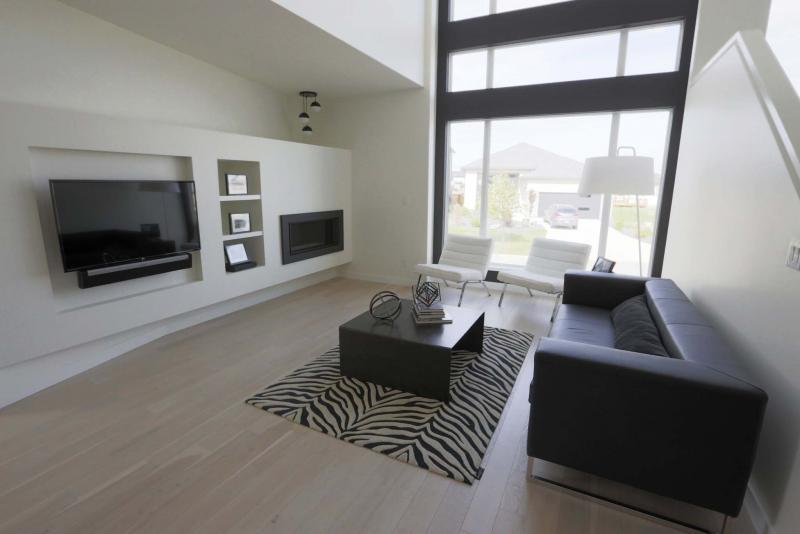<p>JUSTIN SAMANSKI-LANGILLE / WINNIPEG FREE PRESS</p><p>The main floor living-room of the Sage Creek home at 3 Vireo Lane features a massive floor-to-ceiling window for abundant light.</p>