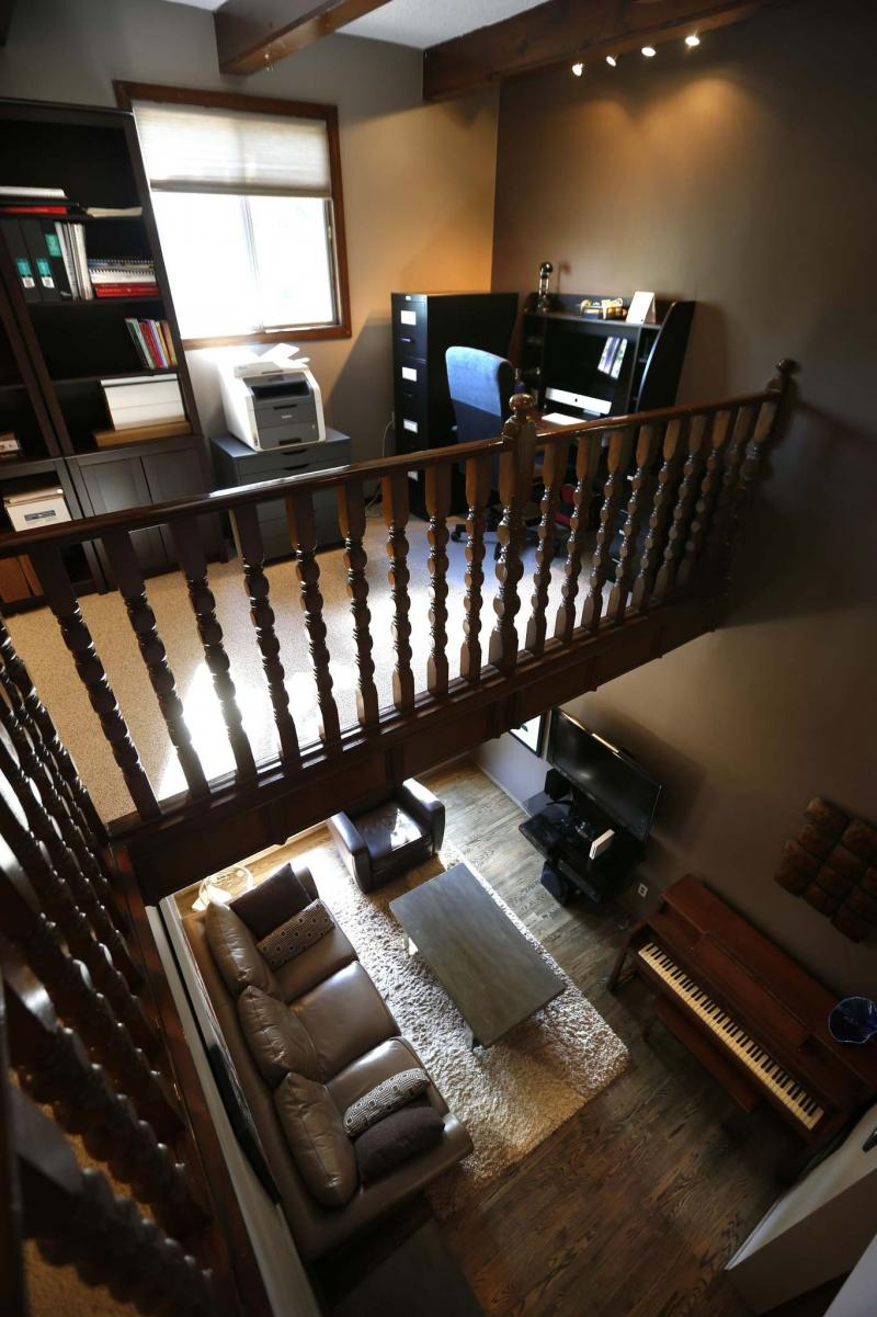 <p>The view from the second-floor office overlooking the living room. </p>