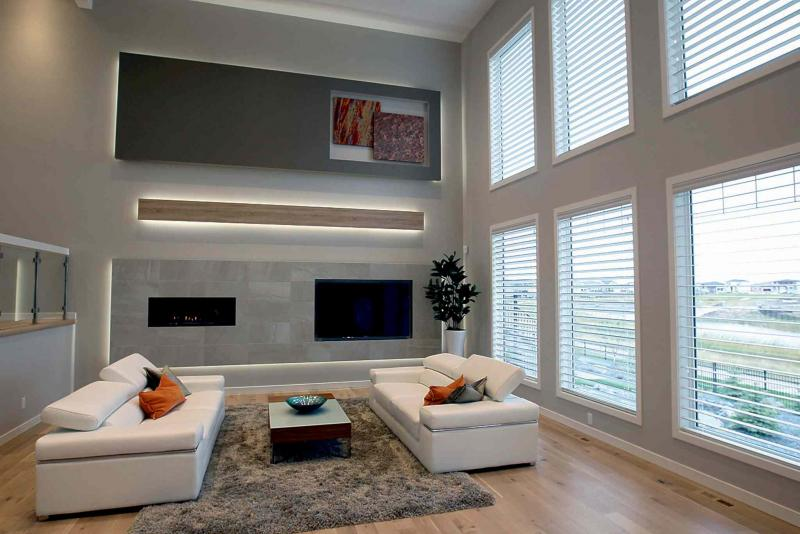 The family room has soaring ceilings, six floor-to-ceiling windows and tile entertainment unit (with ribbon-style fireplace and niche for 70-inch flat panel TV.)