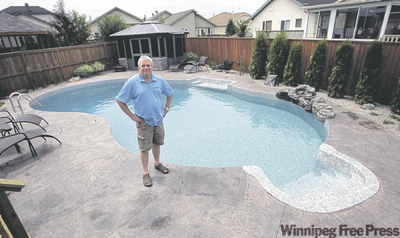 Average backyard really big splash winnipeg free press for Pool design 974