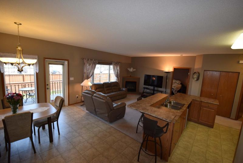 <p>Photos by Todd Lewys / Winnipeg Free Press</p><p>A picture window in the living room, rear door to the patio and a vertical window in the dining room keep the main area illuminated.</p>