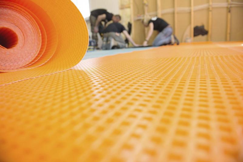 <p>The Holmes Group</p><p>Proper underlayment and subfloor systems are crucial to prevent mould and preserve the flooring in areas where moisture is an issue, such as in the basement, kitchen and bathroom.</p>