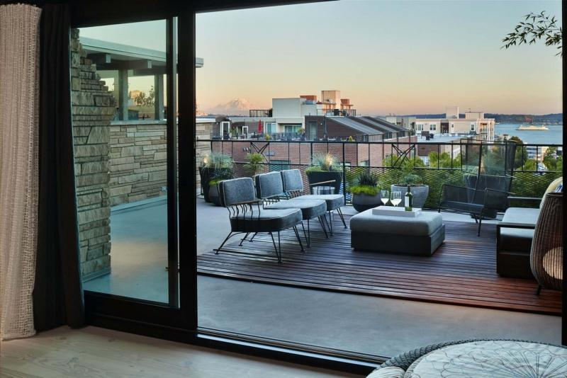 <p>Photos by Benjamin Benschneider / The Seattle Times</p><p>The giant sliders to the terrace often stand completely agape as if boundaries have no business in this condo.</p>