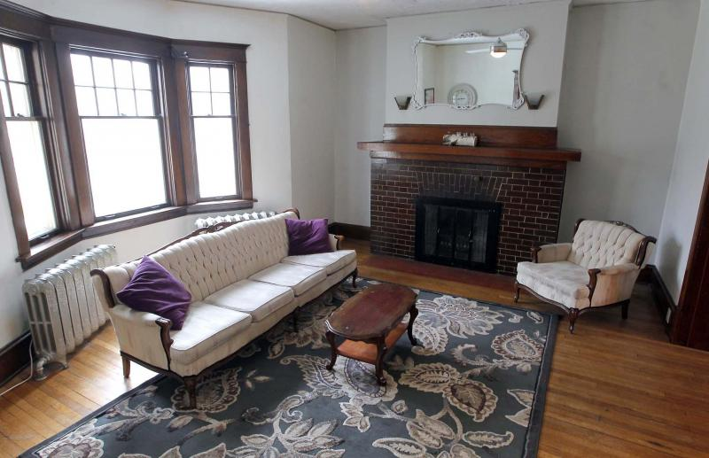 <p>BORIS MINKEVICH / WINNIPEG FREE PRESS</p><p>The front living room features a huge bay window on its front wall, high ceiling and beautiful brick fireplace.</p>