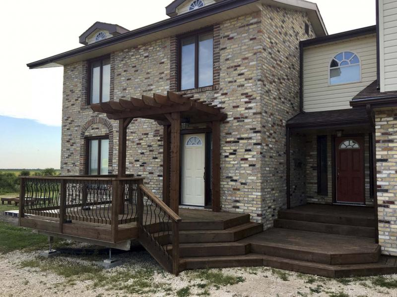 <p>Photos by Marc LaBossiere / Winnipeg Free Press</p><p>The front deck of my home looks much better now that it has had a proper reapplication of stain.</p></p>