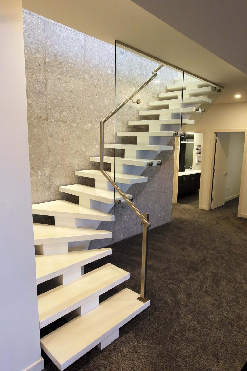 <p>BORIS MINKEVICH / WINNIPEG FREE PRESS FILES</p><p>This 101 Rose Lake Court home is filled with unique touches, such as this designer staircase that links the lower level to the main floor.</p>