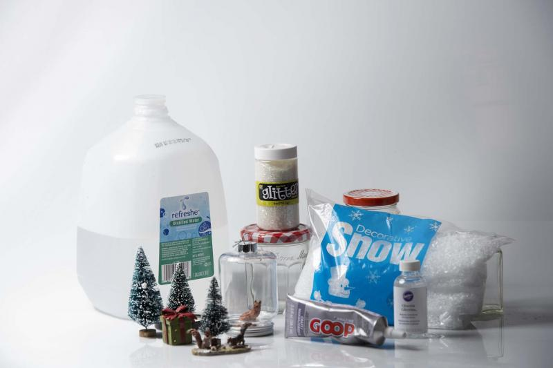 <p>Nikki Kahn / The Washington Post</p><p>Items needed for homemade snow globes include distilled water, ornaments, glitter, empty jars, glue, glycerin and snow flakes. </p>