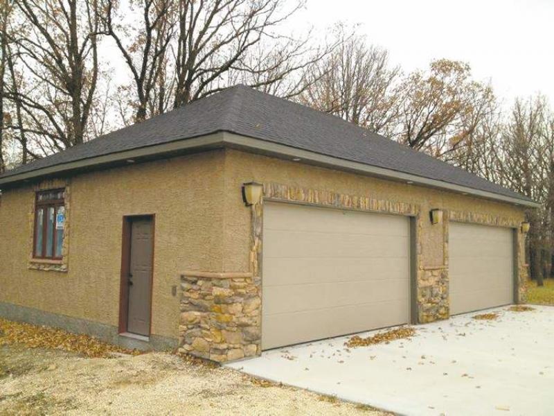 Renovation a garage is no longer just a garage winnipeg for Stucco garage
