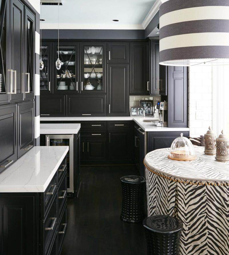 <p>Vern Yip / The Washington Post</p><p>Transitional black and white kitchens are on trend and rising in popularity. Omega's transitional Clio door style in a black opaque finish pairs here with Cambria's Ella quartz countertops to reflect a look that is both fresh and timeless.</p>