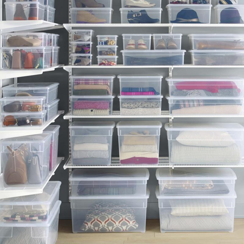 <p>The Container Store</p><p>Use clear, open bins to contain things such as snack bags and bars.</p>