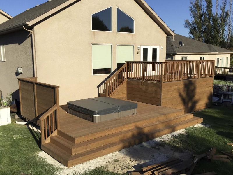 <p>By introducing a visually appealing lower tier to the mix, I was able to avoid having to build an unsightly and massive staircase leading up to the main level of the LaRocque's home from their yard. </p>