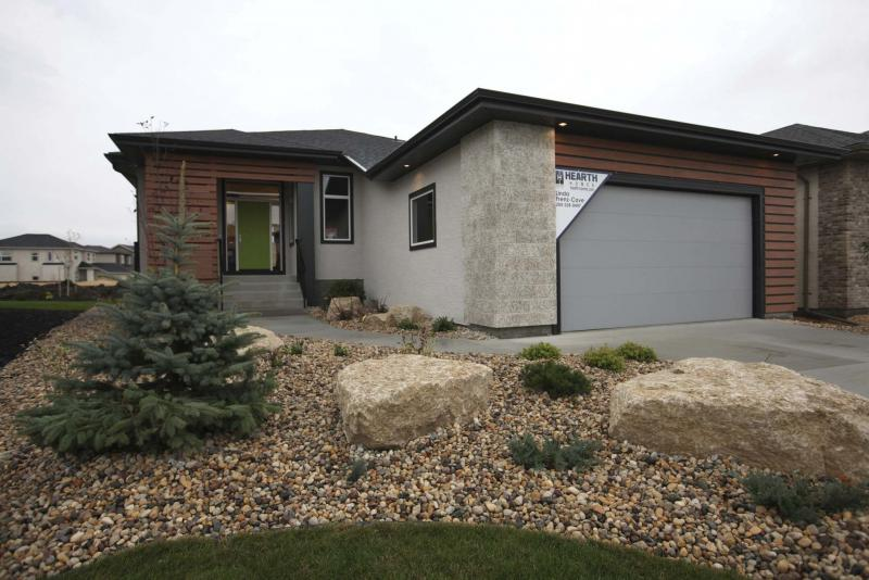 <p>RUTH BONNEVILLE / WINNIPEG FREE PRESS</p></p><p>Homes: Photos of Hearth Homes show home, bungalow, at 14 East Plains Drive in Sage Creek.</p></p></p><p>Oct 03, 2017</p>