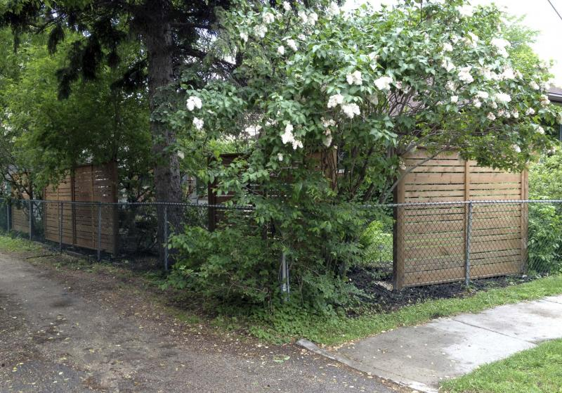 <p>Photos by Marc LaBossiere / Winnipeg Free Press</p><p>Custom-built privacy panels, fastened to end posts that are counter-sunk into the ground, hint at a backyard sanctuary that lies behind the walls.</p>