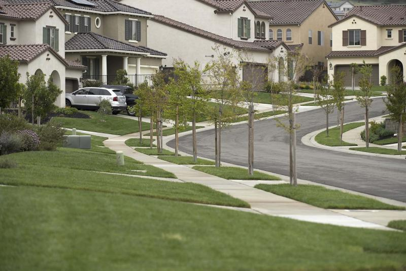 <p>Randall Benton / Sacramento Bee</p><p>Although it might seem natural to cut the lawn as short as possible, experts recommend letting it grow longer and mowing it more frequently.</p>