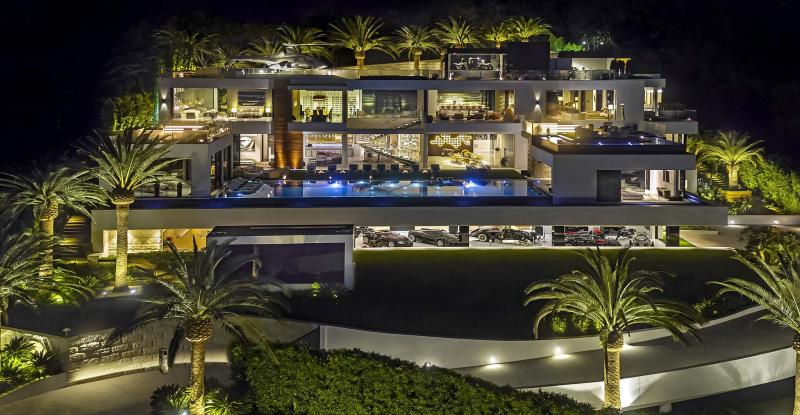 <p>The 38,000-square-foot spec house in Bel-Air took four years and 250 workers to build. A $30-million car collection, custom furnishings and a range of amenities are included in the $250-million price tag. (Bruce Makowsky/BAM Luxury Development)</p>