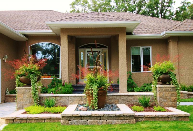<p>B.Rocke Landscaping</p><p>This purposeful, symmetrical design features stone pillars and stone walls in varying heights.</p></p></p>