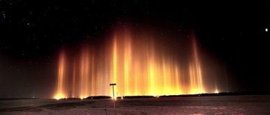 PHIL.HOSSACK@FREEPRESS.MB.CA 101130-Winnipeg Free Press Columns of light reach skyward to the stars above Sanford Mb Tuesday night. The effect is produced by streetlights refracting through ice crystals suspended in the air on humid winter nights. Stand Up.....