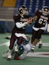 Marc Gallant/Winnipeg Free Press. Sports- High School Football. Oak Park Raiders/St. Paul Crusaders. Canad Stadium. Crusaders QB #12 Madison Leitch breaks away from sack attempt. November 8, 2002.
