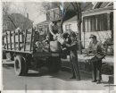 Winnipeg Free Press Archives Winnipeg WWII Home Front April 23, 1942 Boulevards Yielding Treasures in Salvage Cartons, bags, boxes and containers piled in front of your next door neighbor's house no longer means that they are moving cut. It mear.s that the Patriotic Salvage Corps' new boulevard pick-up system is in full swing. Salvage collectors and their trucks were snapped by the Free Press cameraman, Thursday morning, while working; on Arlington street.