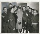 Winnipeg Free Press Archives Winnipeg WWII Home Front February 1, 1940 Ukrainians in Uniform Mrs Con. Genik, president of the Ukrainian Women's council, is pictured with, Ukrainian members of practically all major lighting units who .were guests of ten Ukrainian ,women's societies at a dinnerdance in Provista auditorium, Wednesday evening, when about 50 Canadian Ukrainians were feted by fellow-countrymen.
