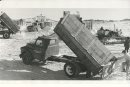 Gerry Cairns/Winnipeg Free Press Archives Winnipeg Blizzard (5) March 5, 1966 Dumptrucks - City snow dump - Louise Bridge  fparchive