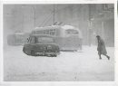 Jack Ablett/Winnipeg Free Press Archives Winnipeg Blizzard (8) March 5, 1966 A car sits trapped right In the middle of Portage Avenue. fparchive