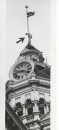 """Winnipeg Free Press Archives Winnipeg Old City Hall (7) July 16, 1957 Maybe B. J. """"Jim"""" Morrissett hasn't heard about the dangers of the city hall tower. For Mere Mr. Morrissett, - and a steeplejack for Fort Rouge Decorating and Sandblasting, doesn't seem to be worried as he scales to the top of the flagpole, 50 feet above the controversial tower. Last week the flagpole rope snapped in a high wind and the flag draped over one of the faces of the tower clock. Jim was called in at 8 a.m.. Tuesday to pass a new rope through the pulley at the top of the pole. This is the third time he has been up in the last, several years and he says  that """"it's getting a little shakier each time."""" fparchive"""