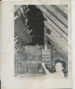 Ted Byfield/Winnipeg Free Press Archives St. James-air-crash Feb. 18 1957 Mrs. Mary Mair, 422 Collegiate St., examines her attic, where the roof was partially sheared off by the 4-ton Mitchell Bomber which crash landed in St. James on Sunday night. The RCAF plane ripped a 12 foot strip, from the roof immediately above the room in which she was standing.