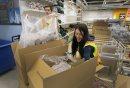 Workers unpack ...